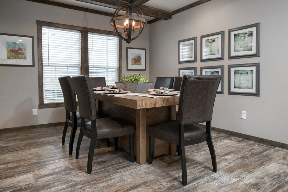 The THE LITTLEFIELD Dining Area. This Manufactured Mobile Home features 3 bedrooms and 2 baths.
