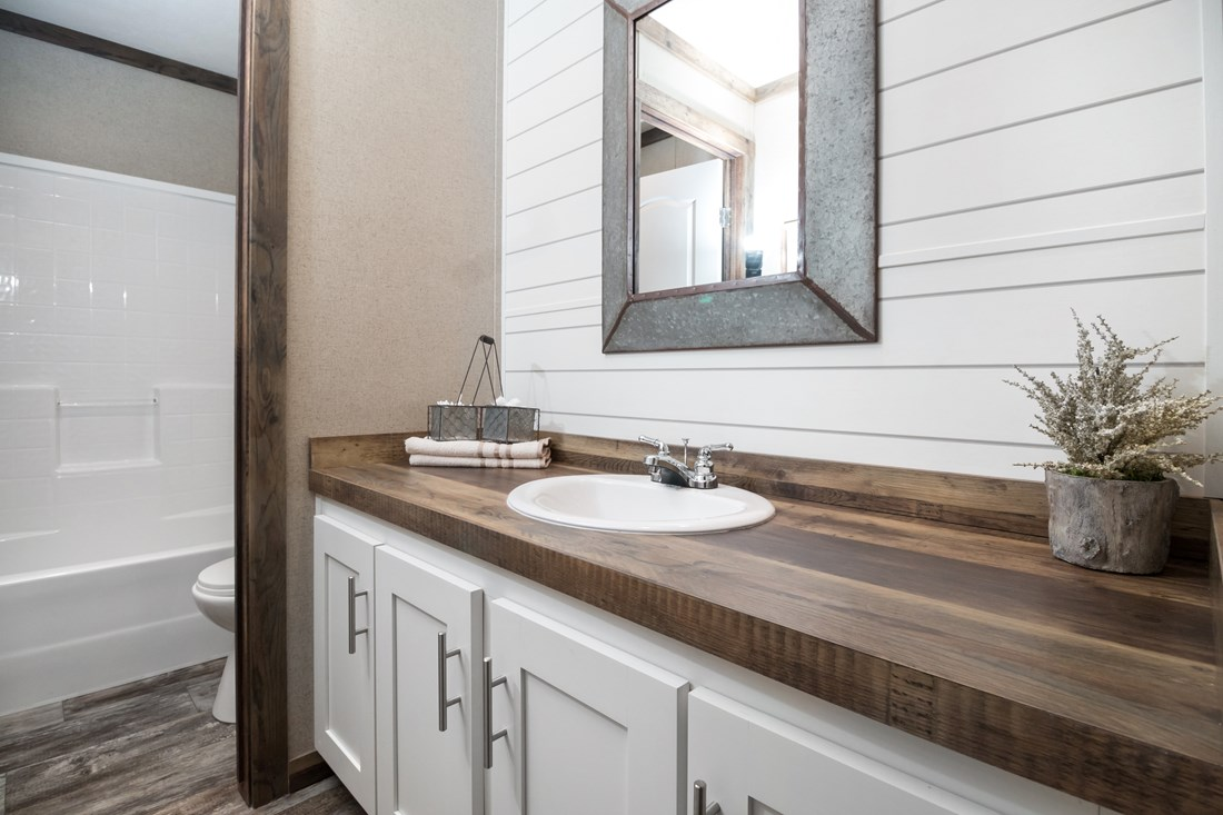 The THE LITTLEFIELD Guest Bathroom. This Manufactured Mobile Home features 3 bedrooms and 2 baths.