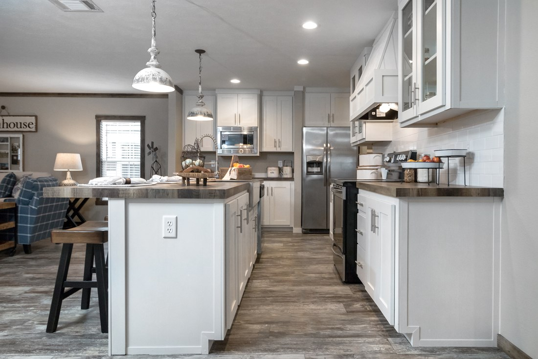 The THE LITTLEFIELD Kitchen. This Manufactured Mobile Home features 3 bedrooms and 2 baths.
