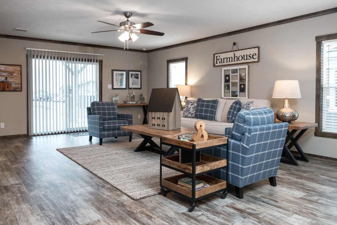 The THE LITTLEFIELD Living Room. This Manufactured Mobile Home features 3 bedrooms and 2 baths.