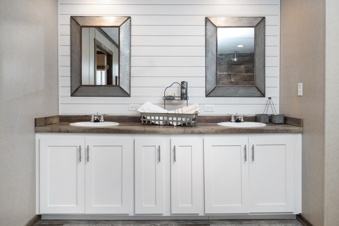 The THE LITTLEFIELD Master Bathroom. This Manufactured Mobile Home features 3 bedrooms and 2 baths.