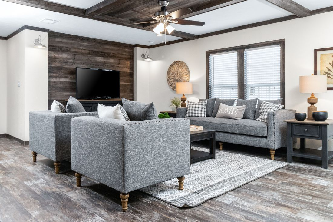 The THE IDALOU Living Room. This Manufactured Mobile Home features 3 bedrooms and 2 baths.
