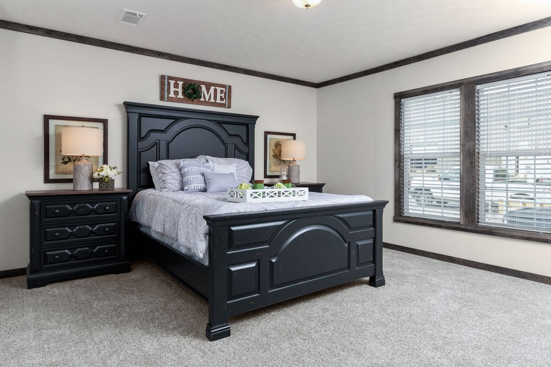 The THE IDALOU Master Bedroom. This Manufactured Mobile Home features 3 bedrooms and 2 baths.
