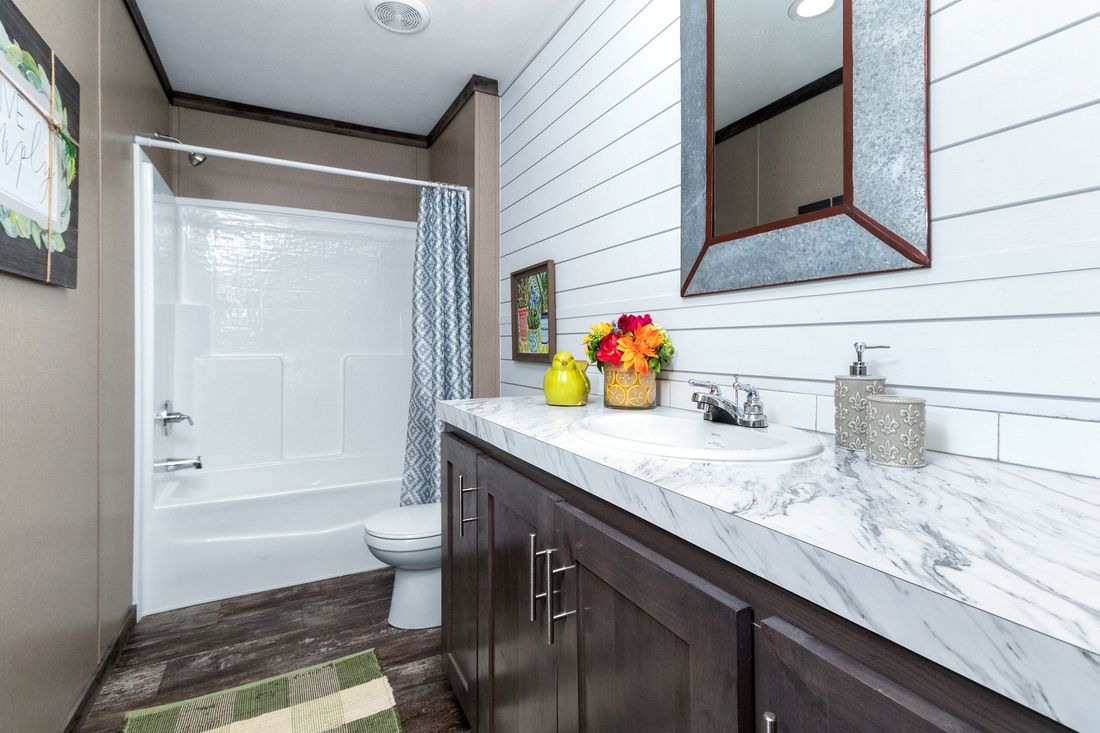 The THE IDALOU Guest Bathroom. This Manufactured Mobile Home features 3 bedrooms and 2 baths.