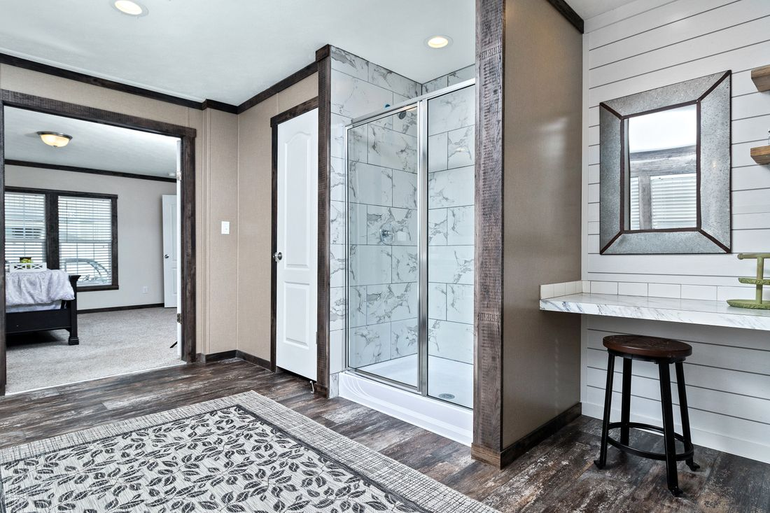The THE IDALOU Master Bathroom. This Manufactured Mobile Home features 3 bedrooms and 2 baths.
