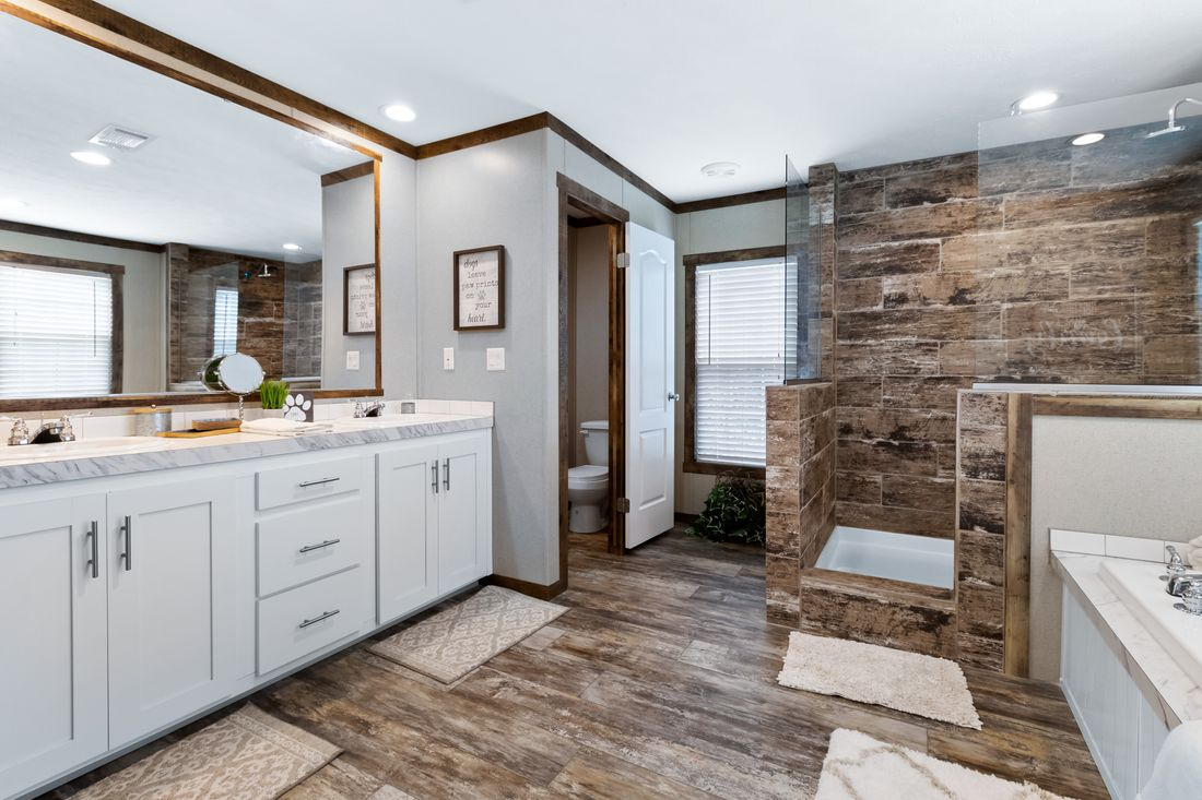 The THE MAVERICK Master Bathroom. This Manufactured Mobile Home features 4 bedrooms and 2 baths.