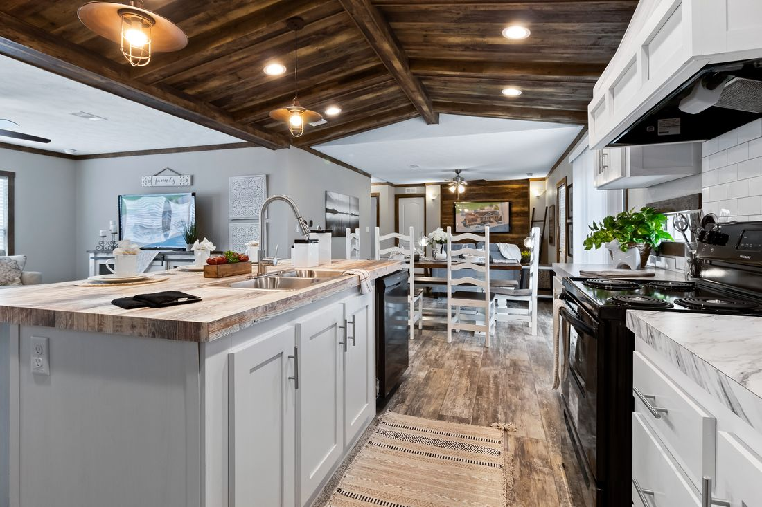The THE MAVERICK Kitchen. This Manufactured Mobile Home features 4 bedrooms and 2 baths.
