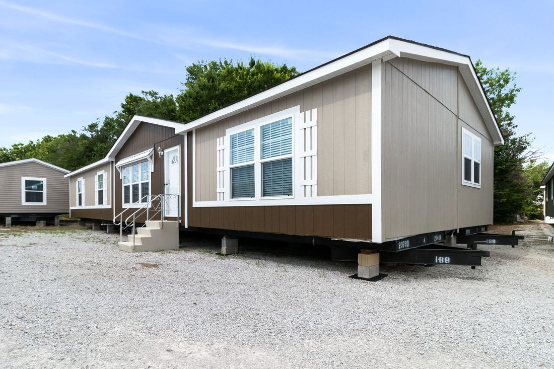 The THE MAVERICK Exterior. This Manufactured Mobile Home features 4 bedrooms and 2 baths.