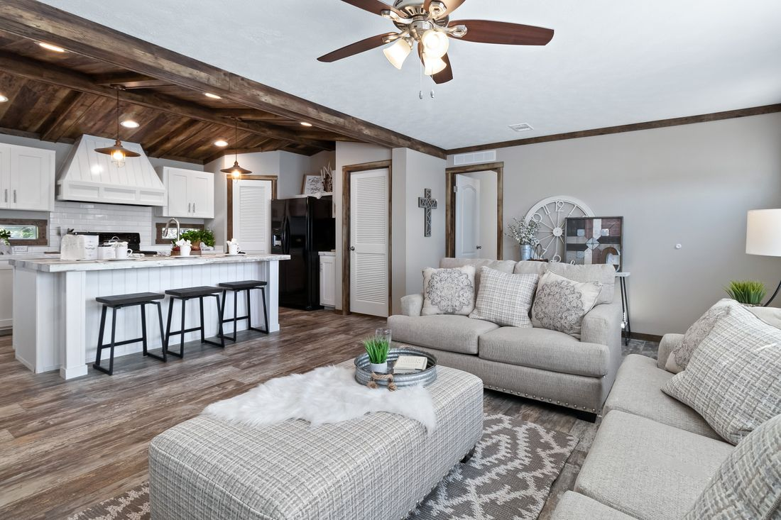 The THE MAVERICK Living Room. This Manufactured Mobile Home features 4 bedrooms and 2 baths.
