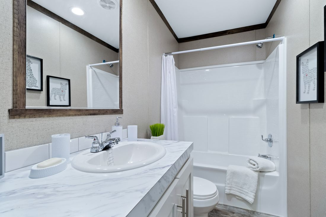 The THE MAVERICK Guest Bathroom. This Manufactured Mobile Home features 4 bedrooms and 2 baths.