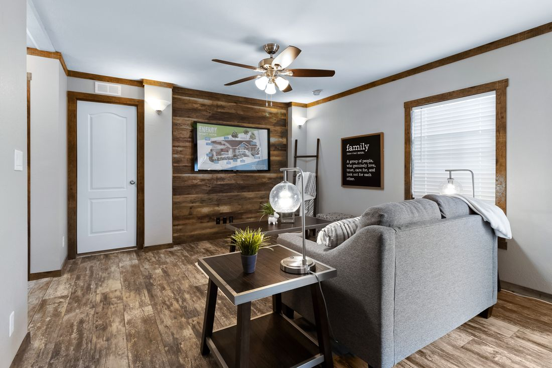 The THE MAVERICK Family Room. This Manufactured Mobile Home features 4 bedrooms and 2 baths.