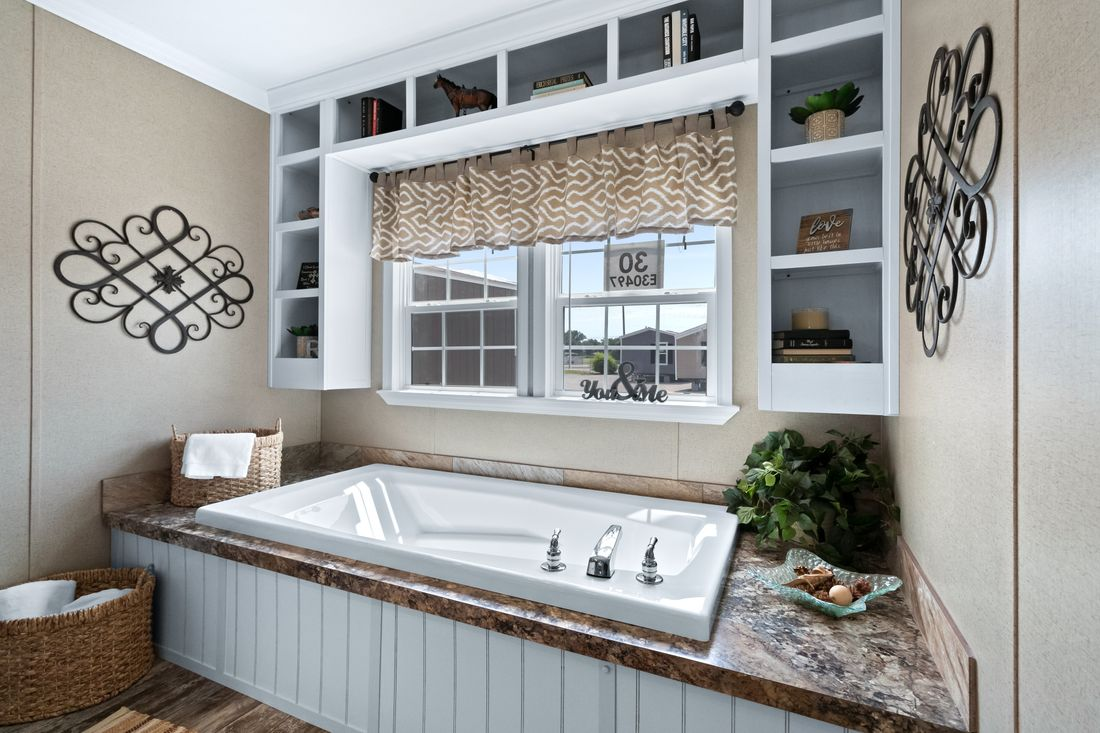The THE MINI DRAKE Master Bathroom. This Manufactured Mobile Home features 3 bedrooms and 2 baths.