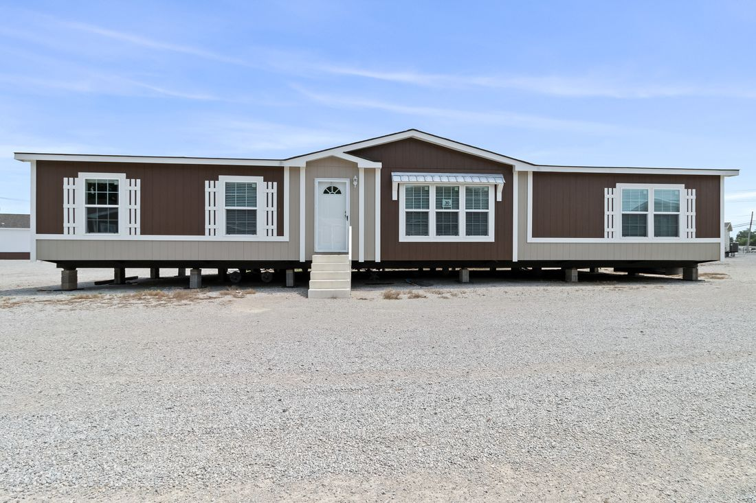 The THE MINI DRAKE Exterior. This Manufactured Mobile Home features 3 bedrooms and 2 baths.