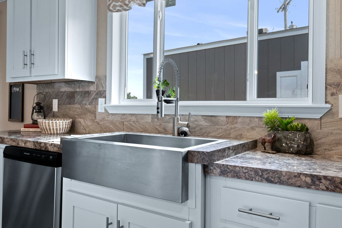 The THE MINI DRAKE Kitchen. This Manufactured Mobile Home features 3 bedrooms and 2 baths.